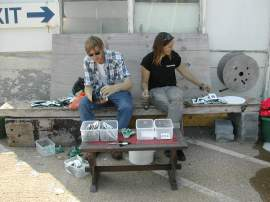 Matt and Lisa washing signs in the sun